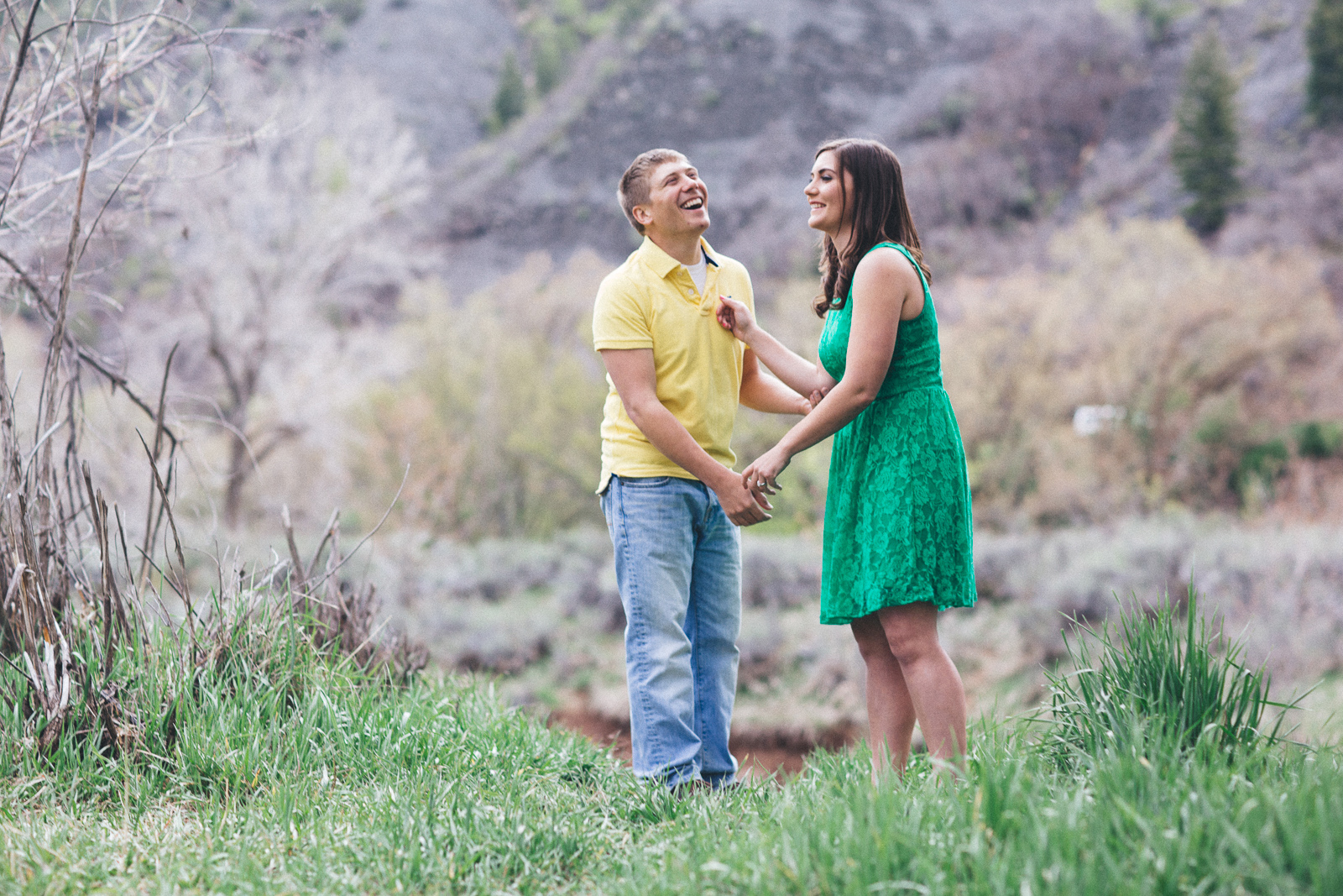 043-engagement-trees-fun-wedding-train-laughing-durango-colorado-farmington-candid