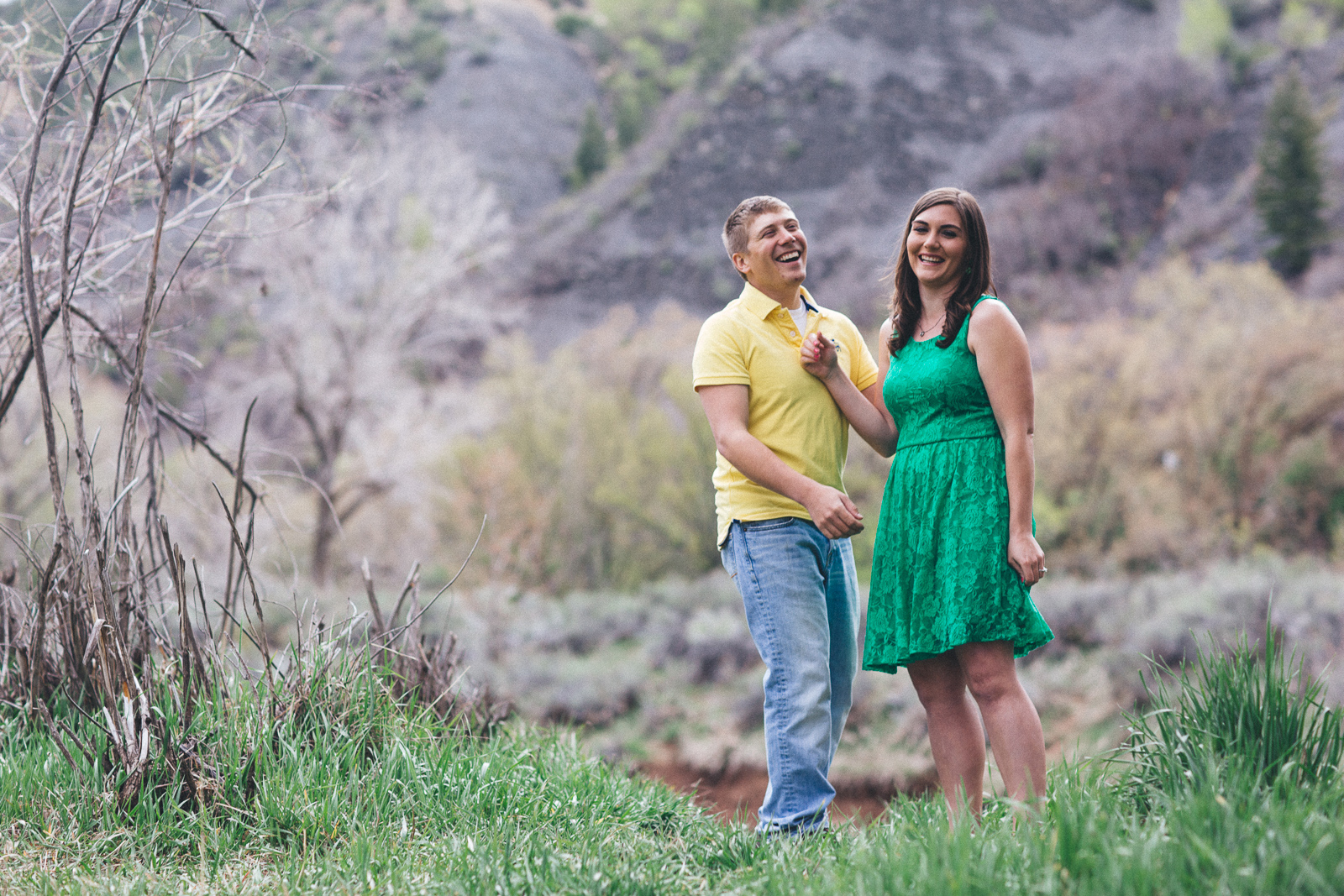 044-engagement-trees-fun-wedding-train-laughing-durango-colorado-farmington-candid