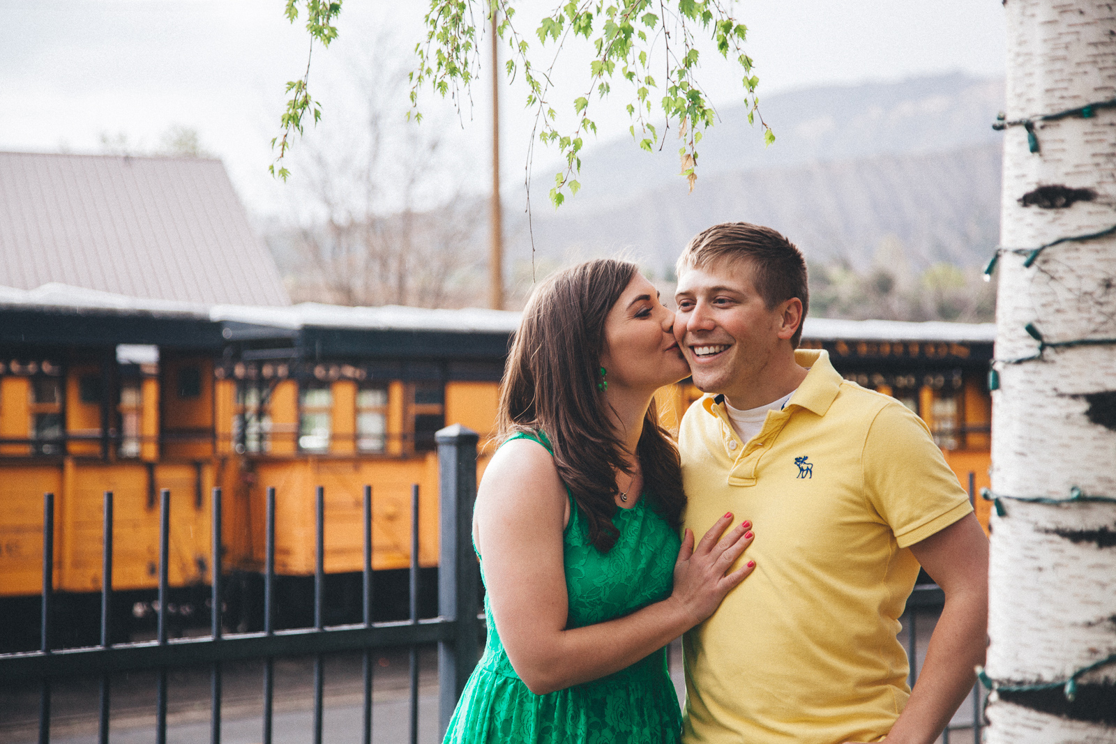 059-engagement-trees-fun-wedding-train-laughing-durango-colorado-farmington-candid-new-mexico