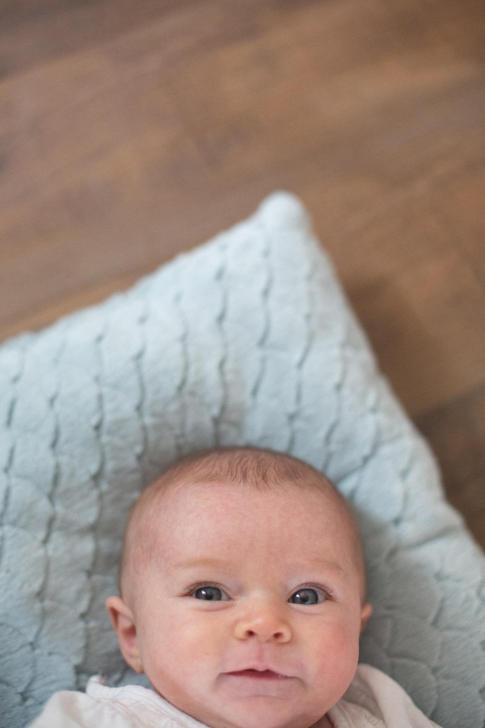 066-newborn-baby-fatherhood-birds-wood-floor-playing-new-mexico-farmington