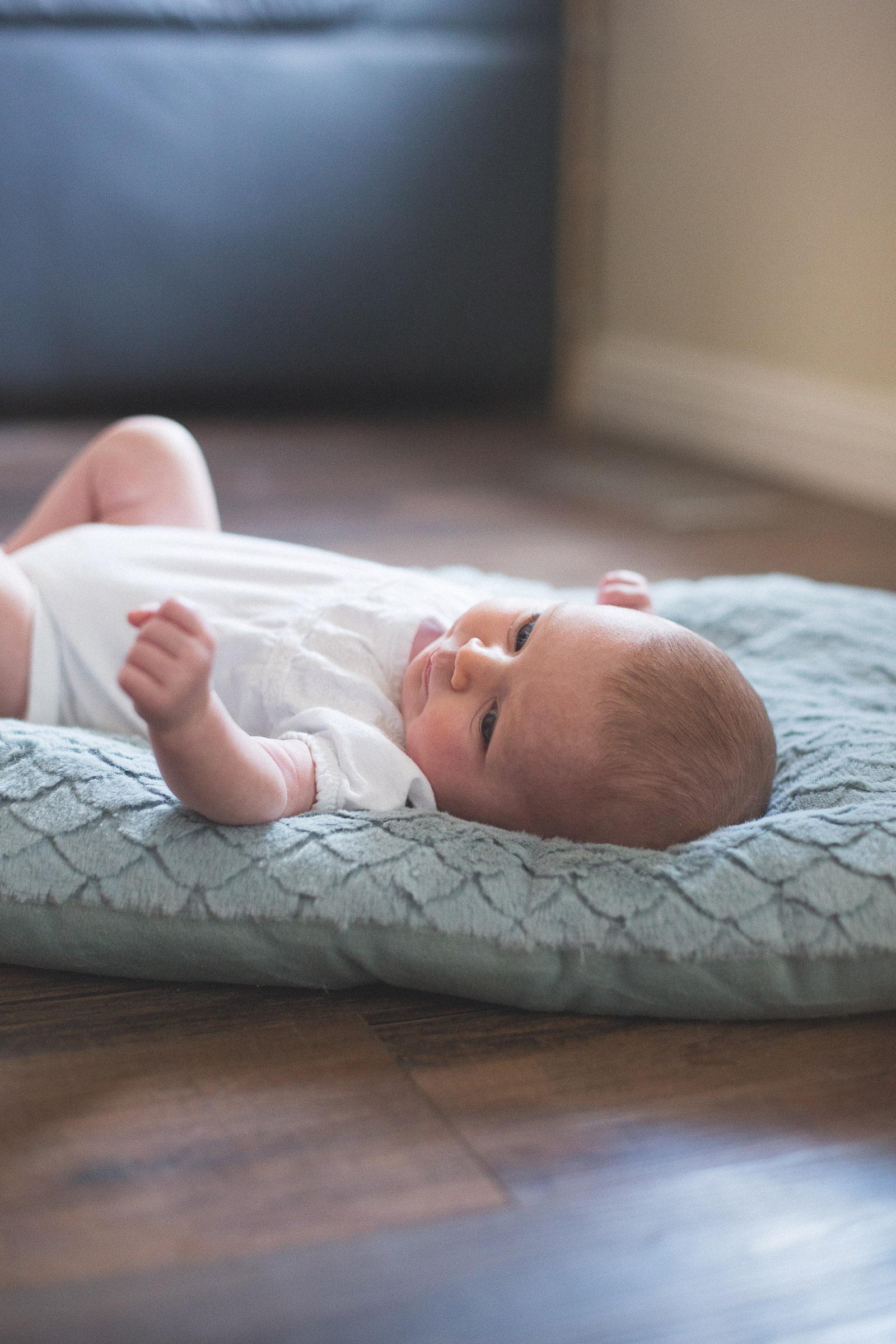 071-newborn-baby-fatherhood-birds-wood-floor-playing-new-mexico-farmington