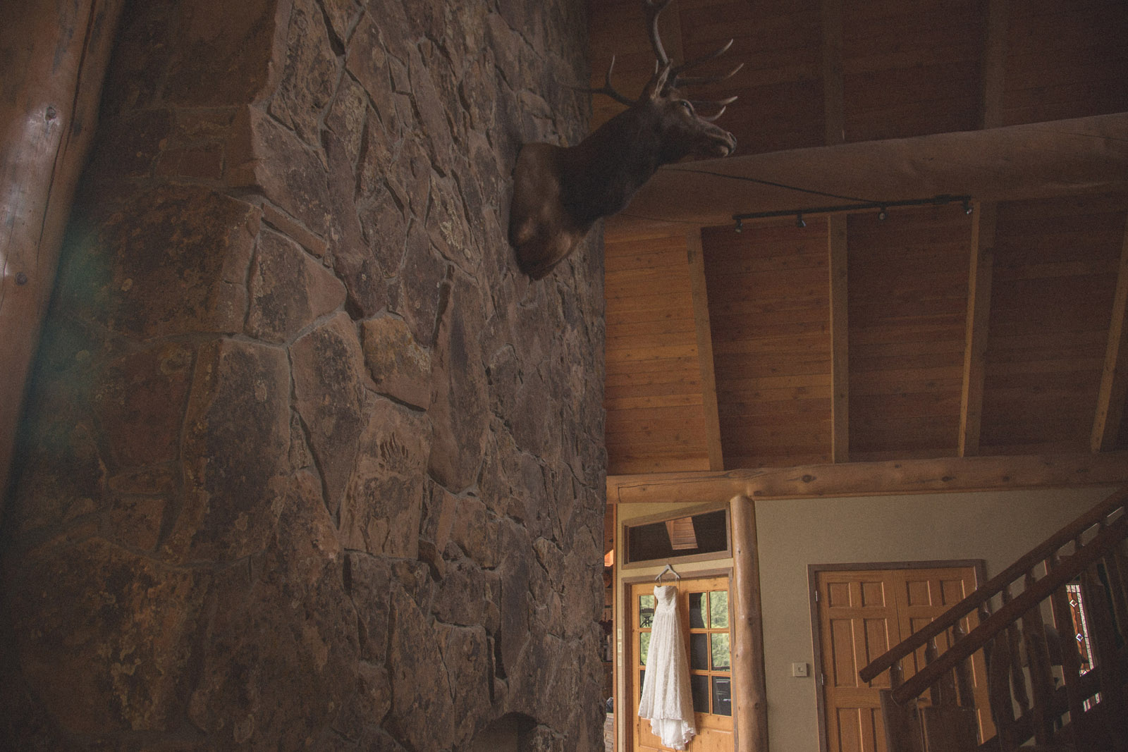 015-wedding-dress-deer-hunting-stairs-light-ambient