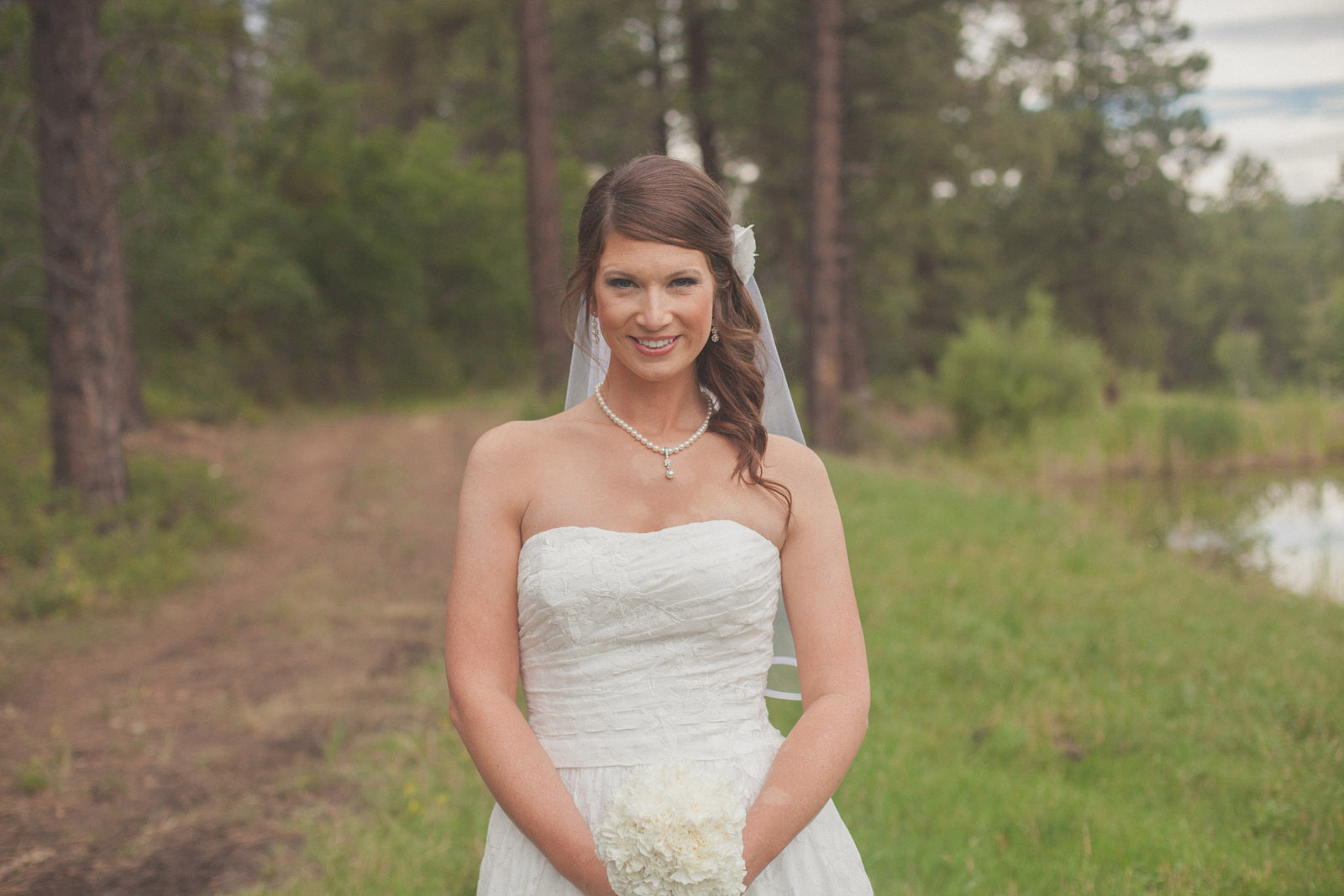 lake bokeh trees groom bride wedding cabin woods forest pictures photos dress photography portraits first look firstlook reveal happy farmington aztec durango mancos co nm