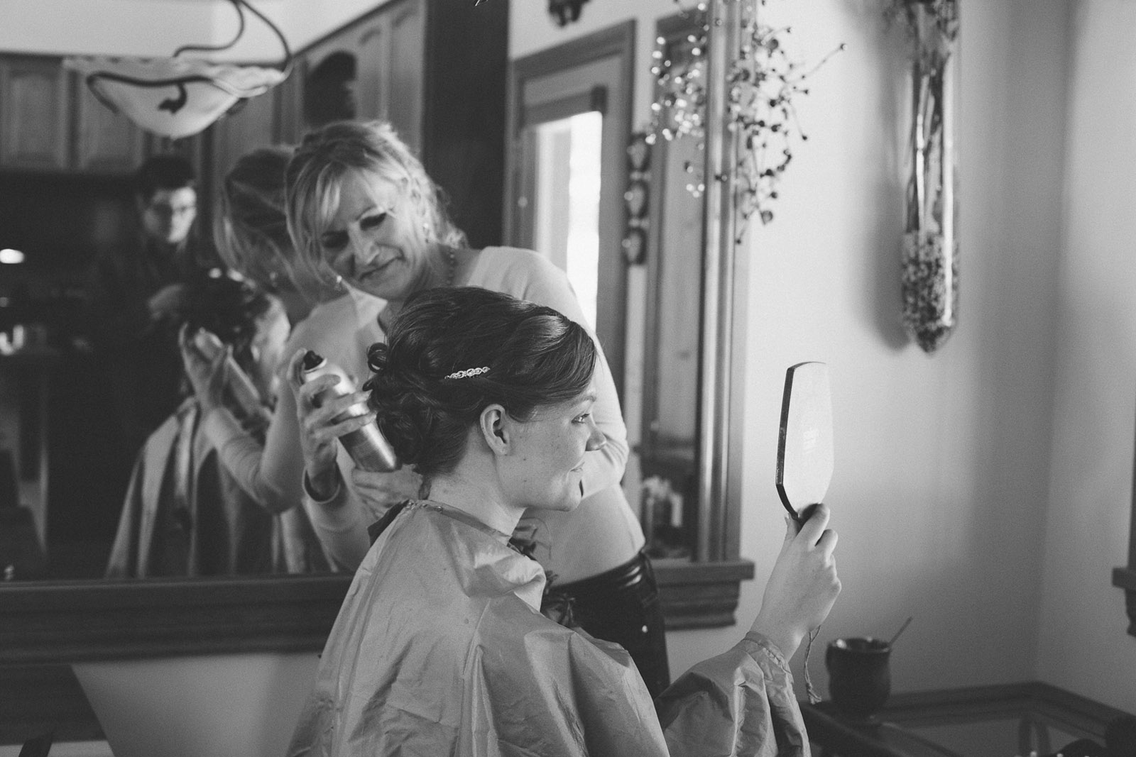 girl getting ready for colorado wedding