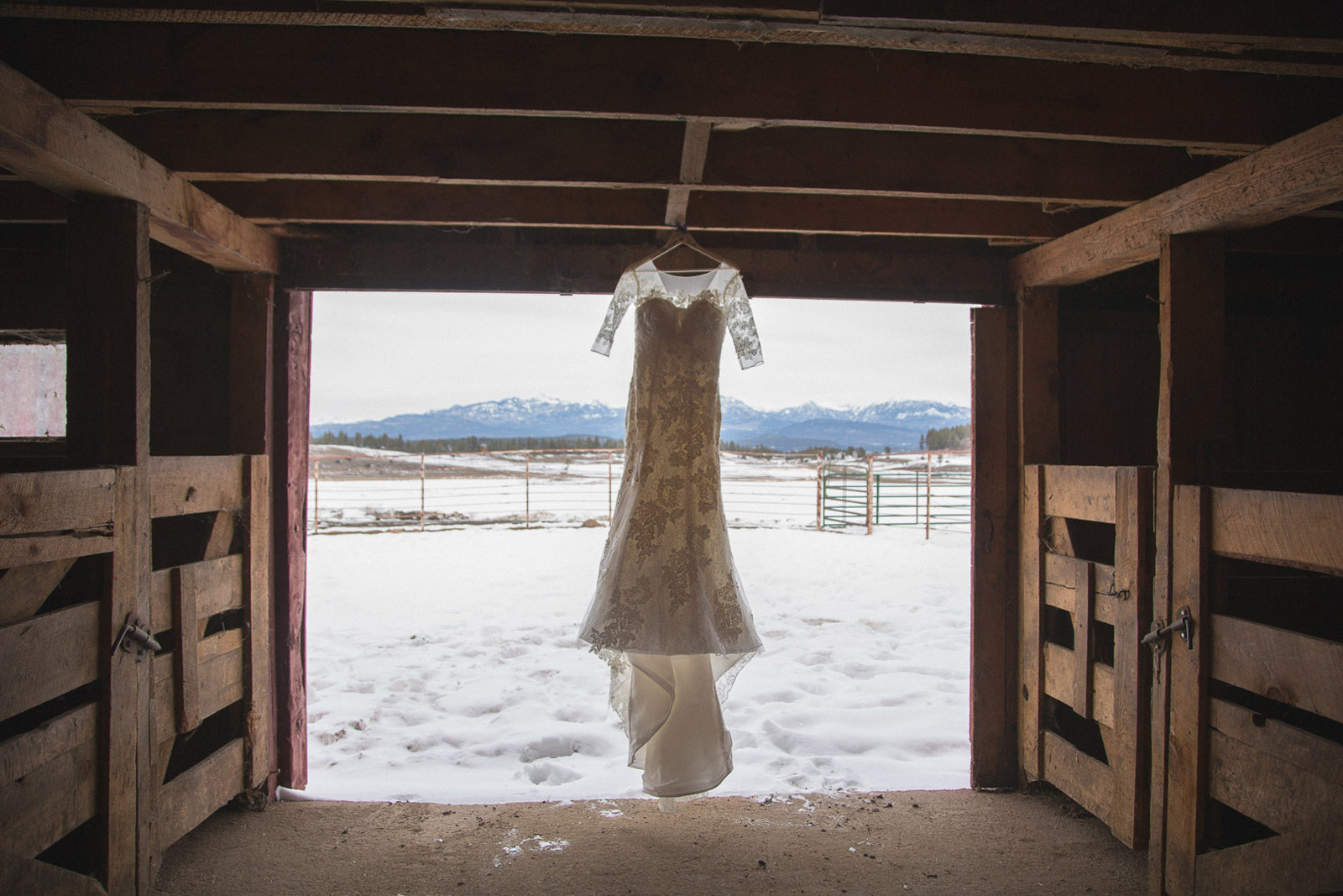 027-wedding-dress-in-red-barn-hanging-for-style-in-pagosa-springs-colorado-for-mirabal-photography