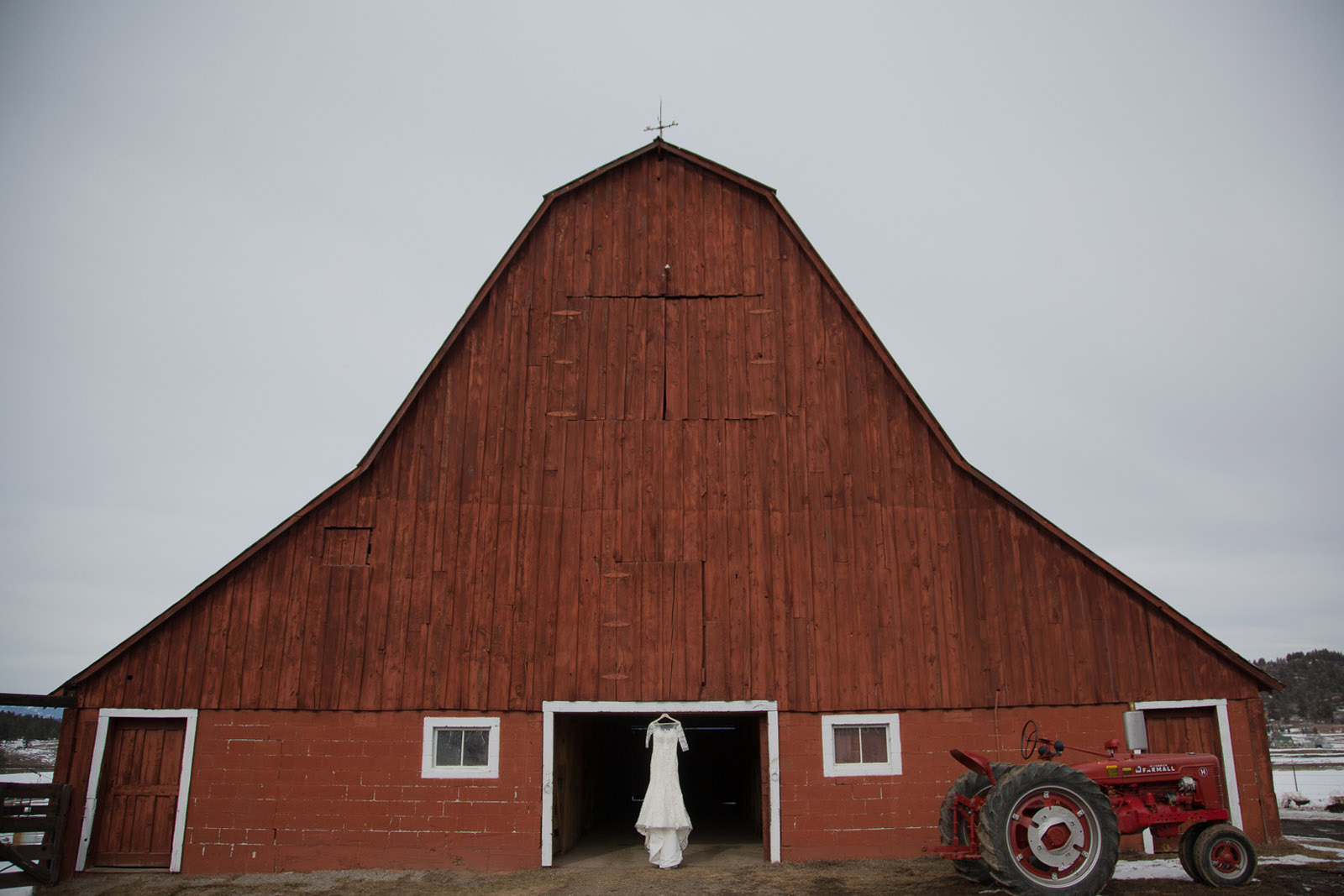 028-wedding-dress-in-red-barn-hanging-for-style-in-pagosa-springs-colorado-for-mirabal-photography