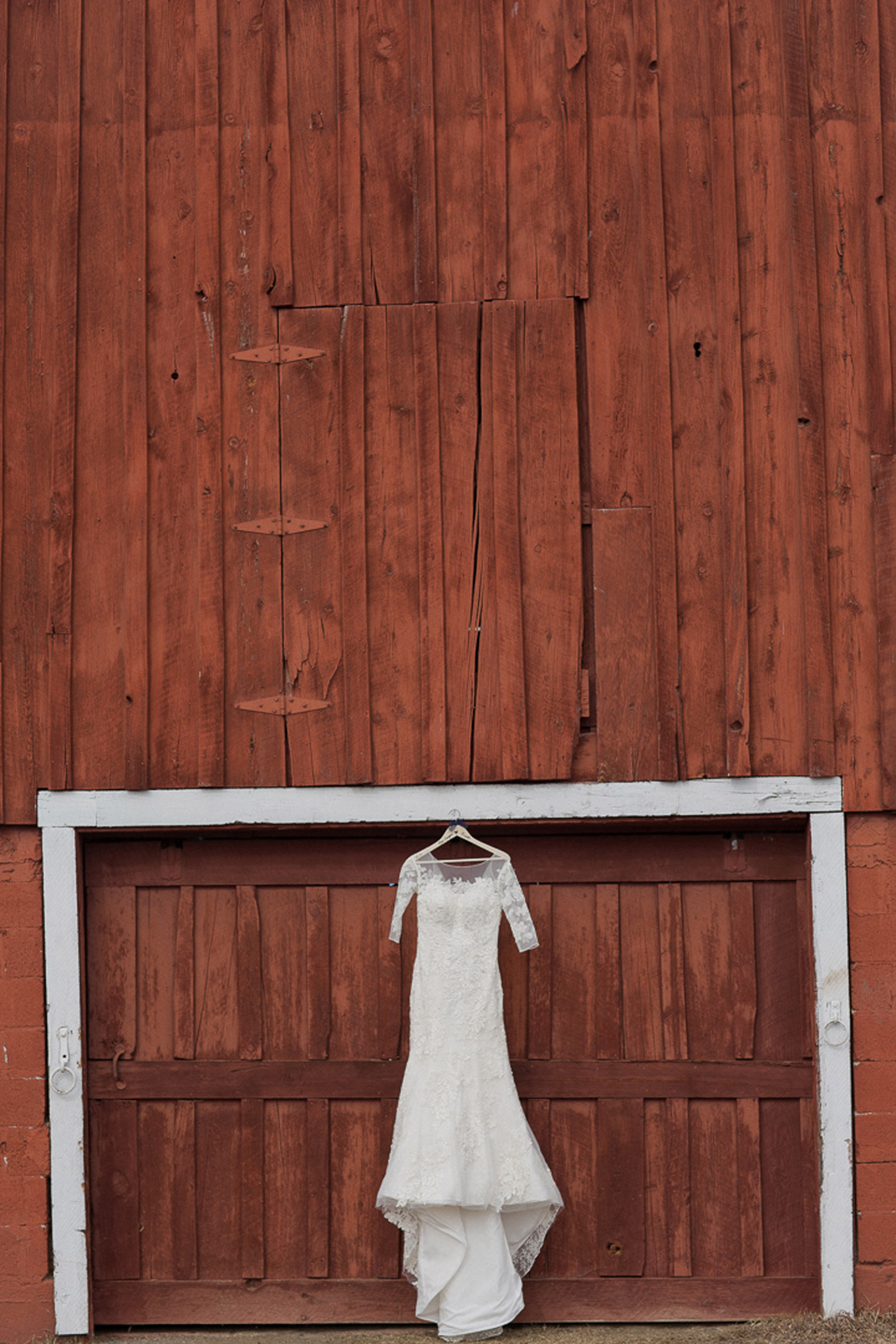 030-wedding-dress-in-red-barn-hanging-for-style-in-pagosa-springs-colorado-for-mirabal-photography