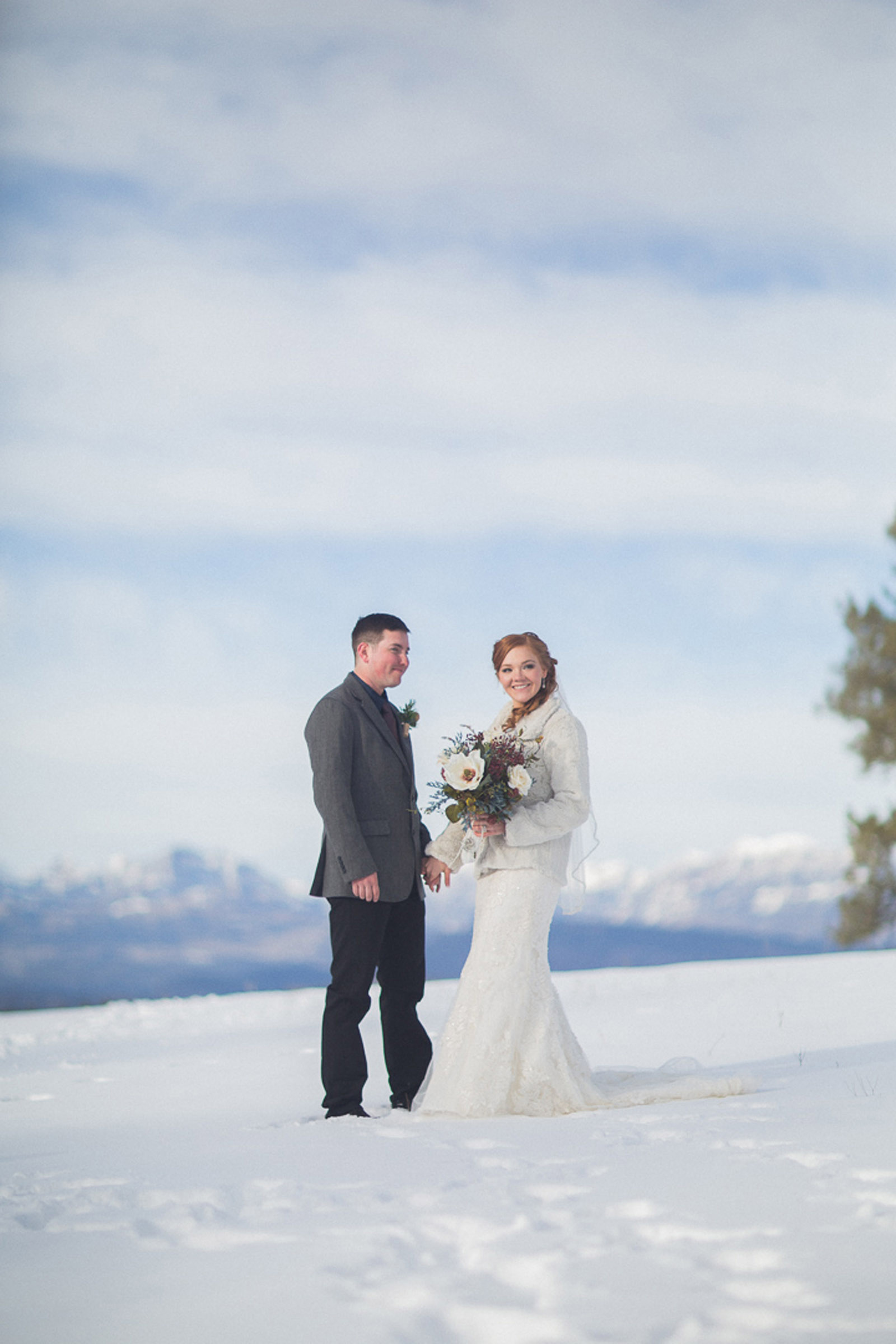 134-wedding-photographer-captures-newlyweds-in-snow-during-a-winter-snow-wedding-in-the-mountains-in-colorado