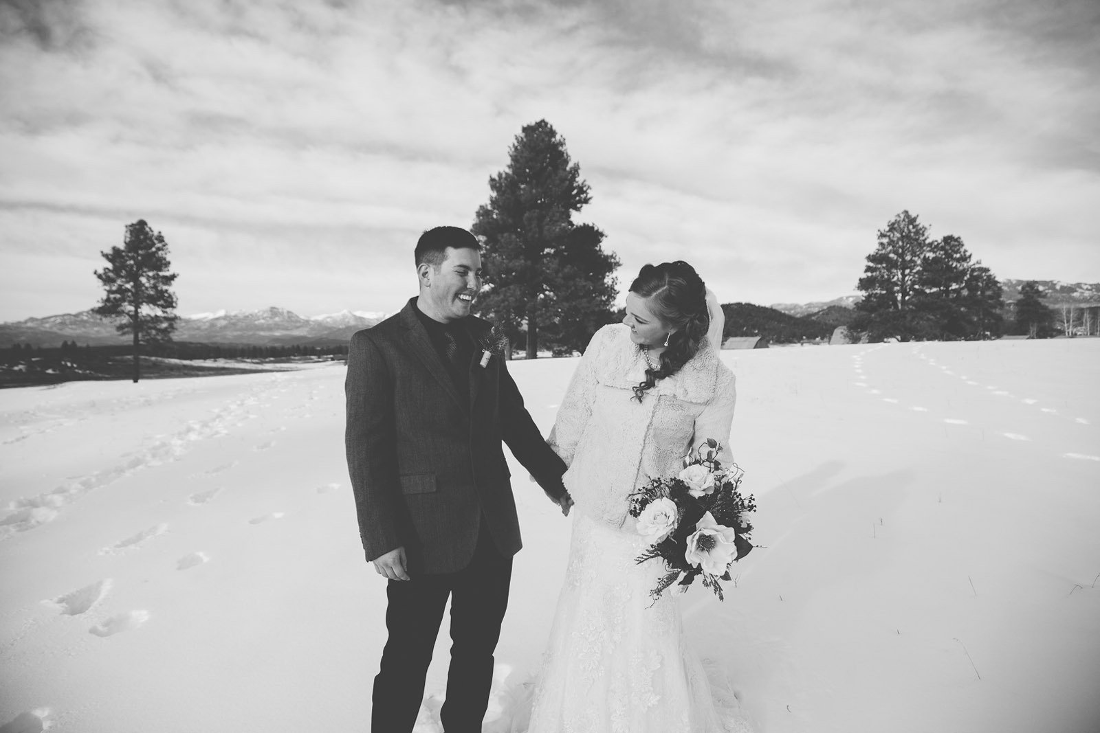 136-wedding-photographer-captures-newlyweds-in-snow-during-a-winter-snow-wedding-in-the-mountains-in-colorado