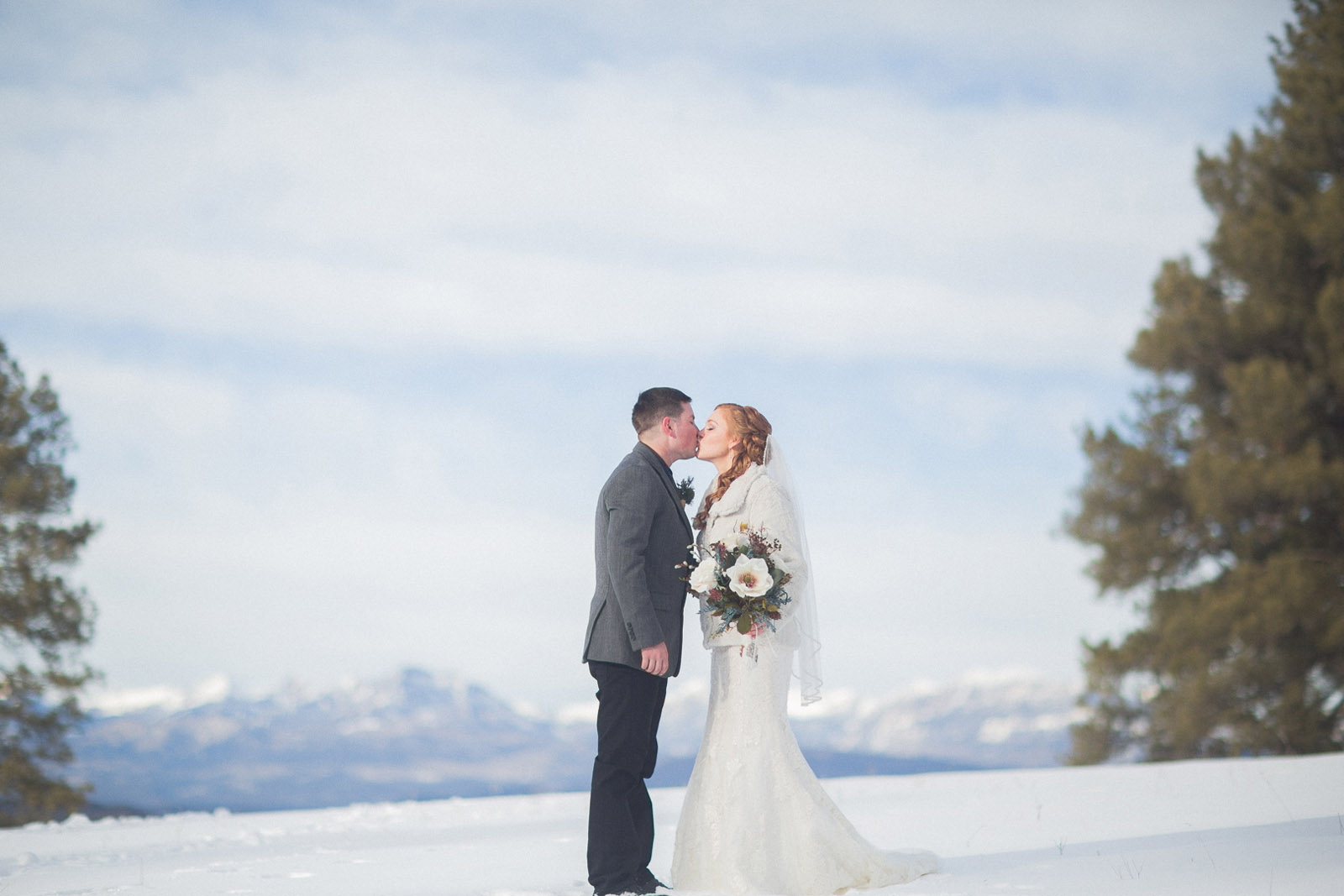 137-wedding-photographer-captures-newlyweds-in-snow-during-a-winter-snow-wedding-in-the-mountains-in-colorado