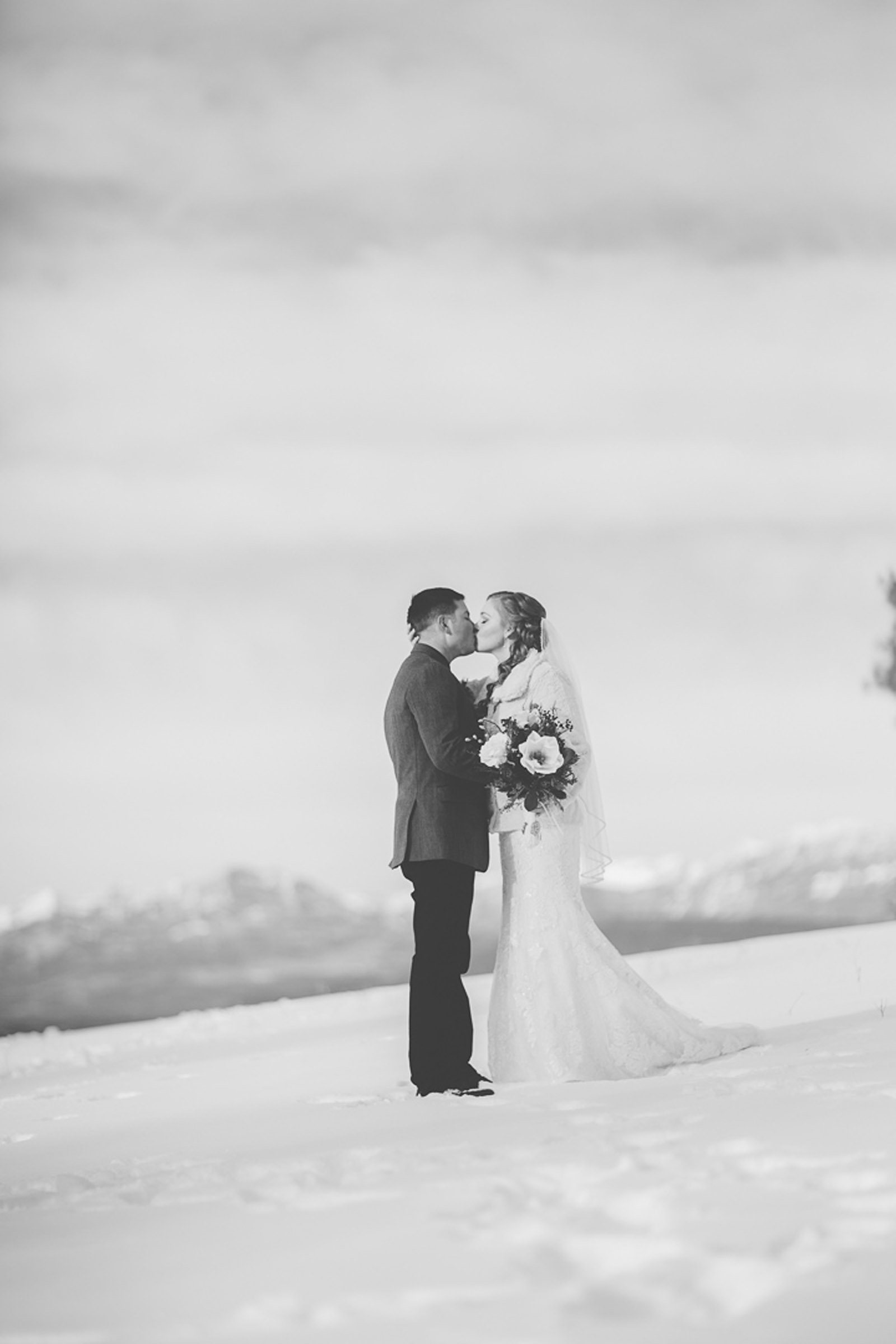 139-wedding-photographer-captures-newlyweds-in-snow-during-a-winter-snow-wedding-in-the-mountains-in-colorado