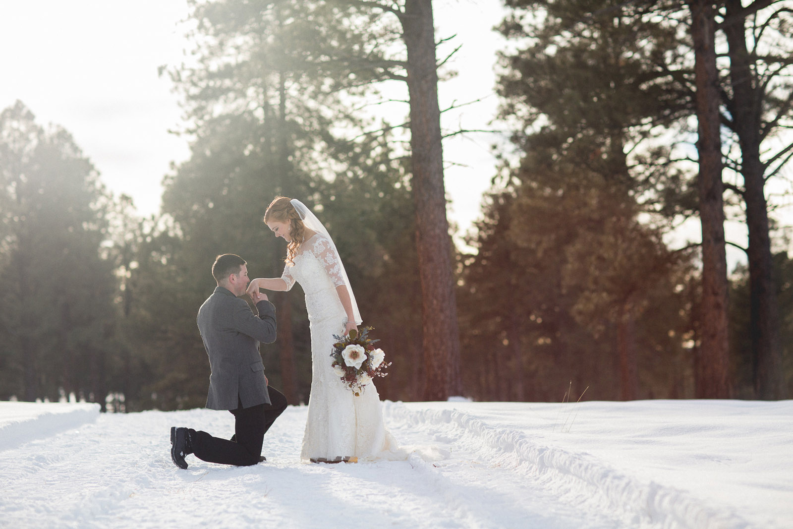 147-wedding-photographer-captures-newlyweds-in-snow-during-a-winter-snow-wedding-in-the-mountains-in-colorado