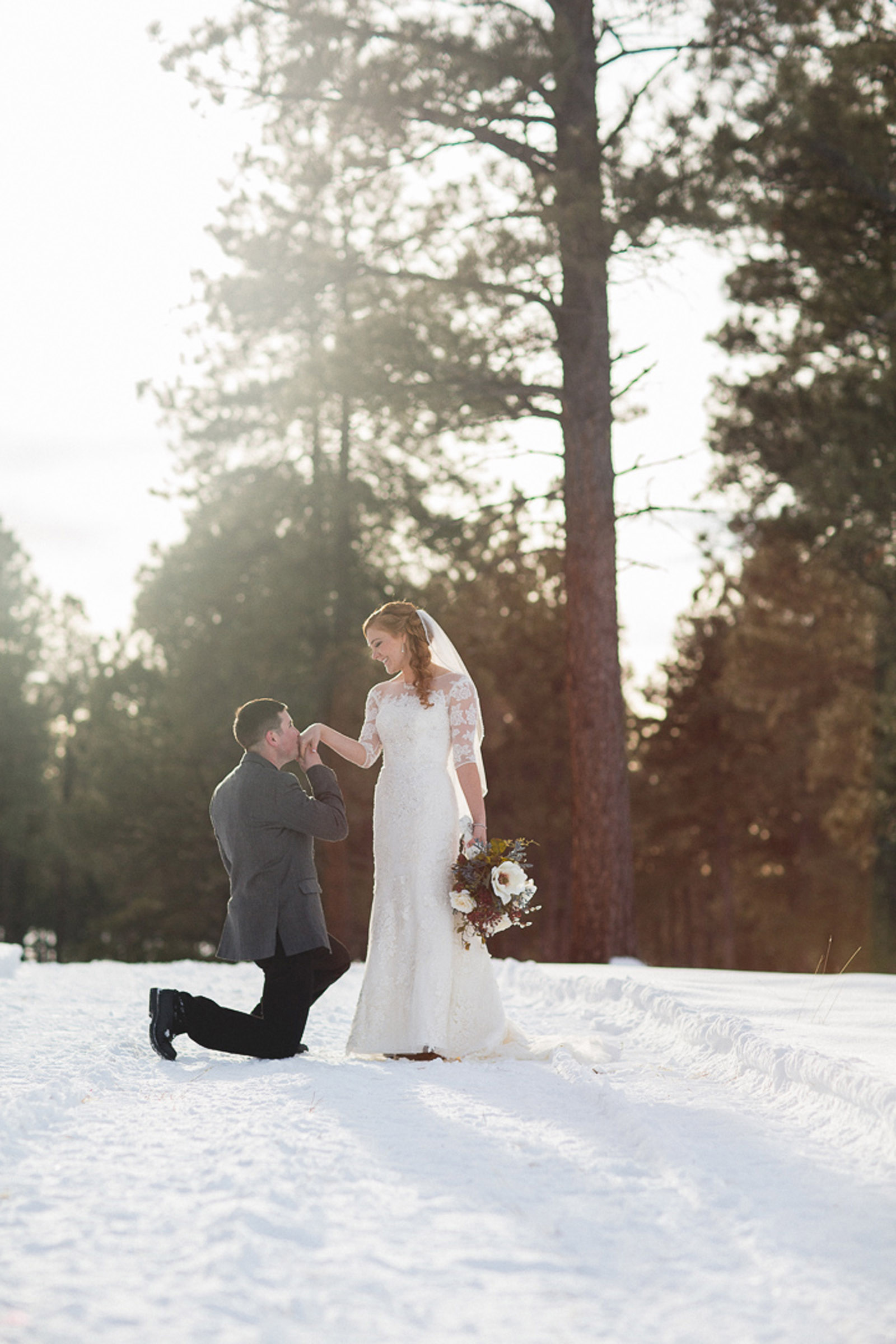 148-wedding-photographer-captures-newlyweds-in-snow-during-a-winter-snow-wedding-in-the-mountains-in-colorado