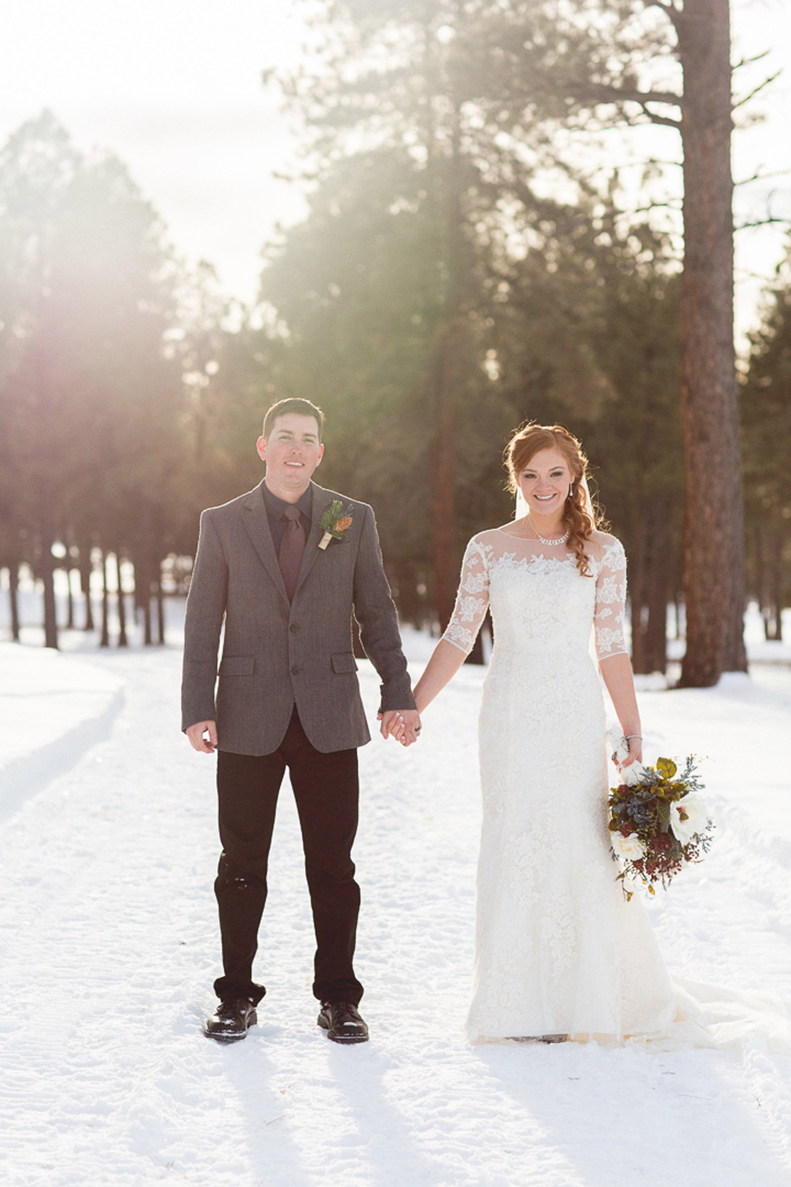 150-wedding-photographer-captures-newlyweds-in-snow-during-a-winter-snow-wedding-in-the-mountains-in-colorado