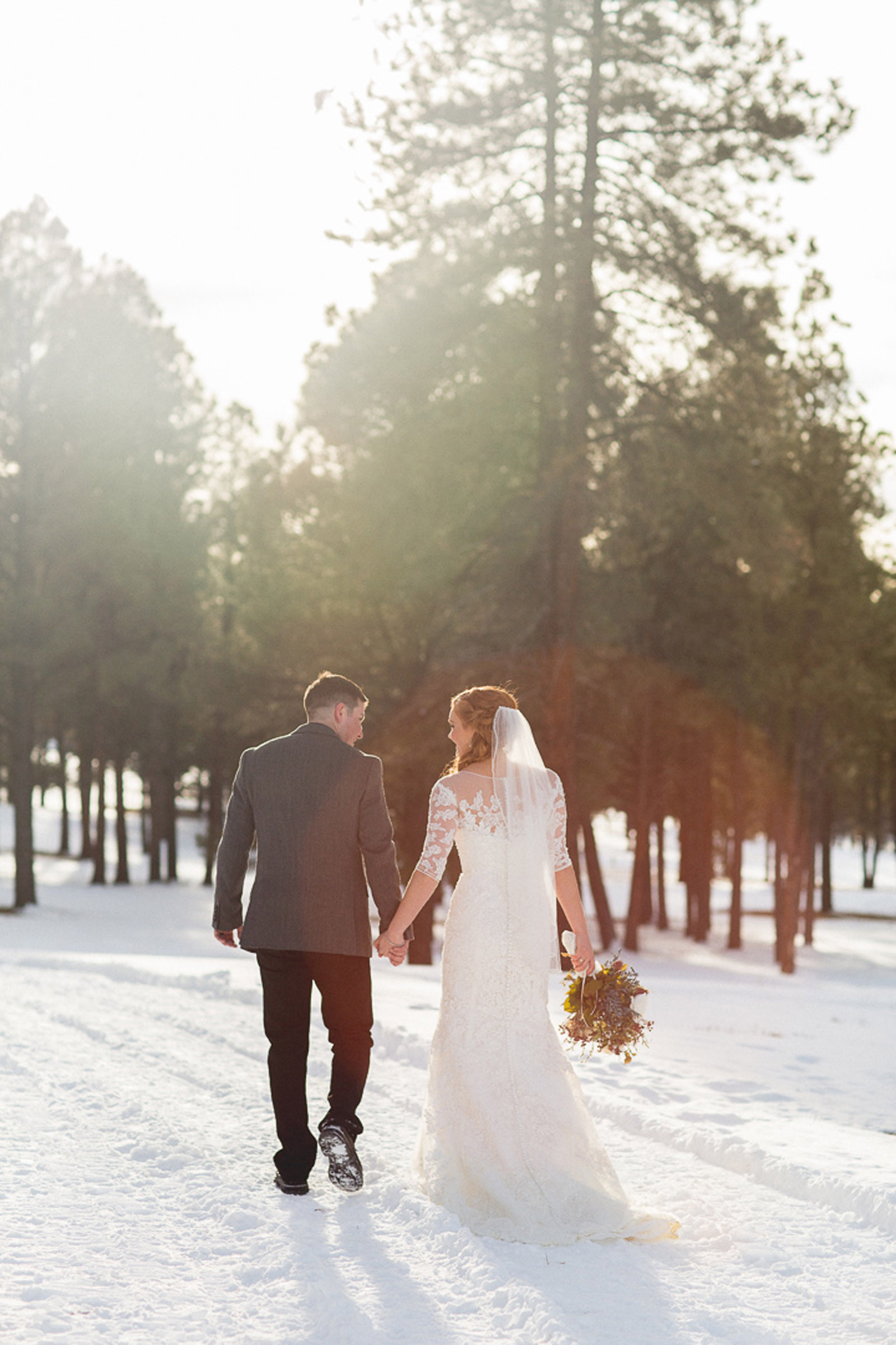 152-wedding-photographer-captures-newlyweds-in-snow-during-a-winter-snow-wedding-in-the-mountains-in-colorado
