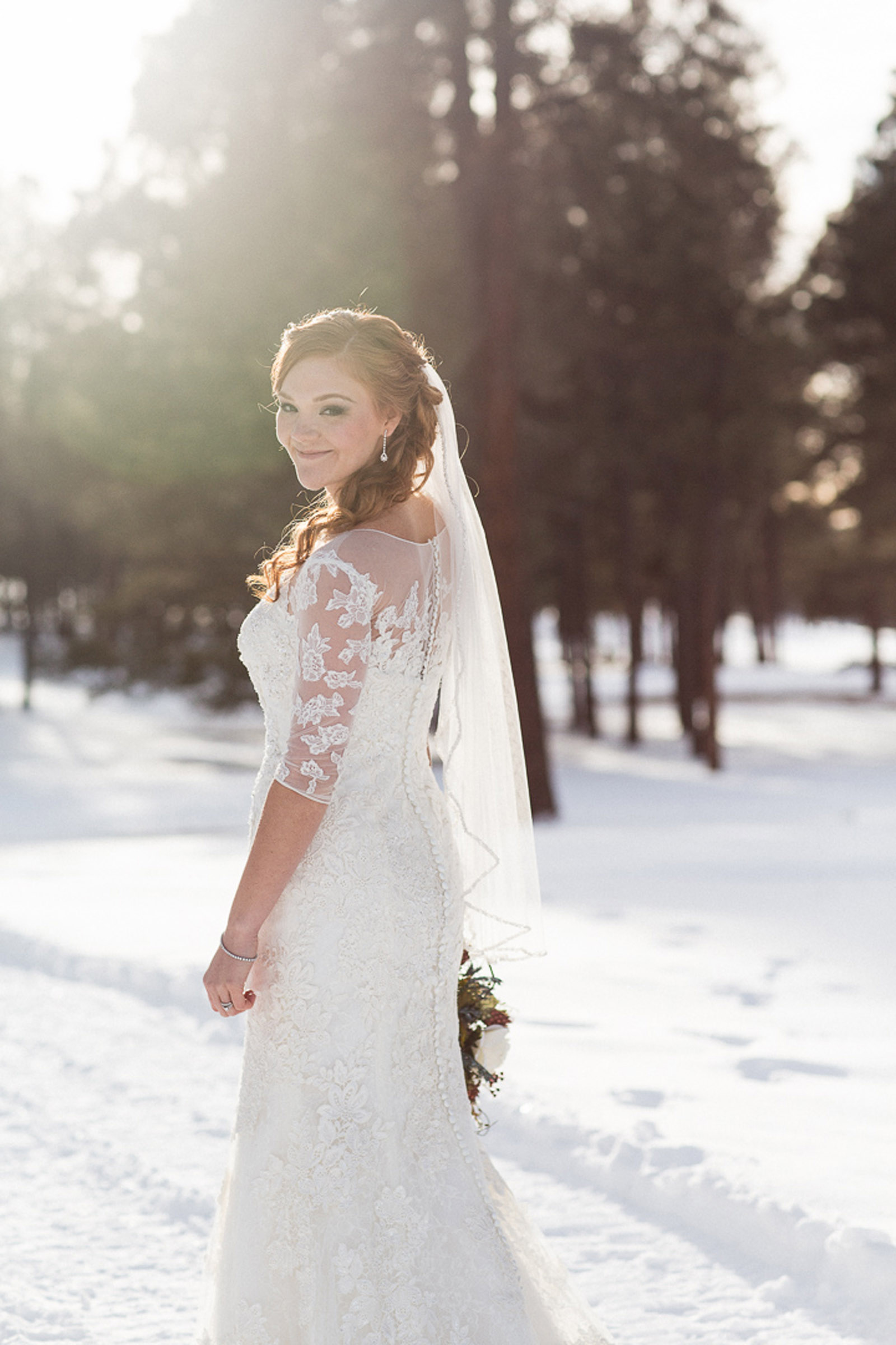 154-wedding-photographer-captures-newlyweds-in-snow-during-a-winter-snow-wedding-in-the-mountains-in-colorado
