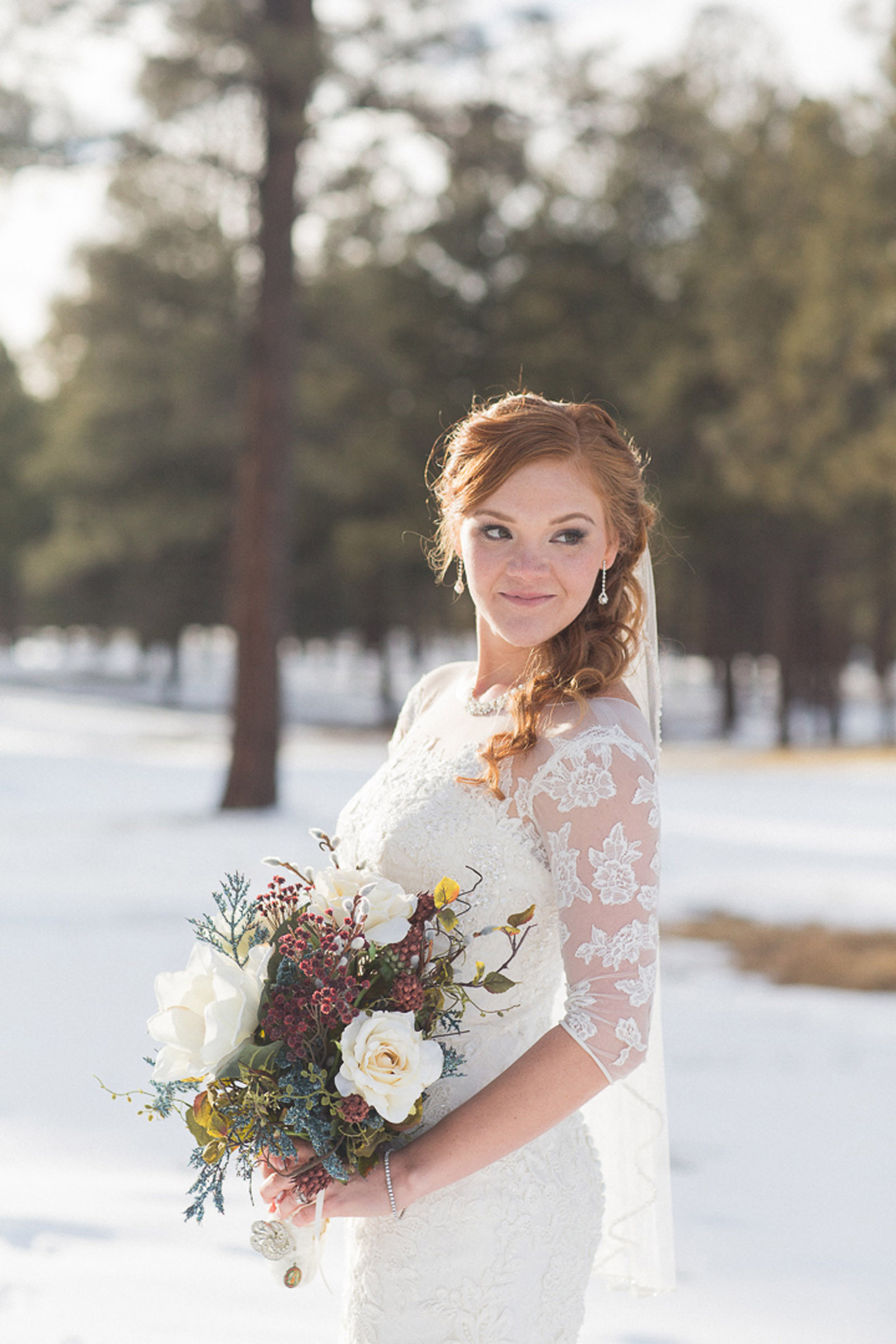 155-wedding-photographer-captures-newlyweds-in-snow-during-a-winter-snow-wedding-in-the-mountains-in-colorado