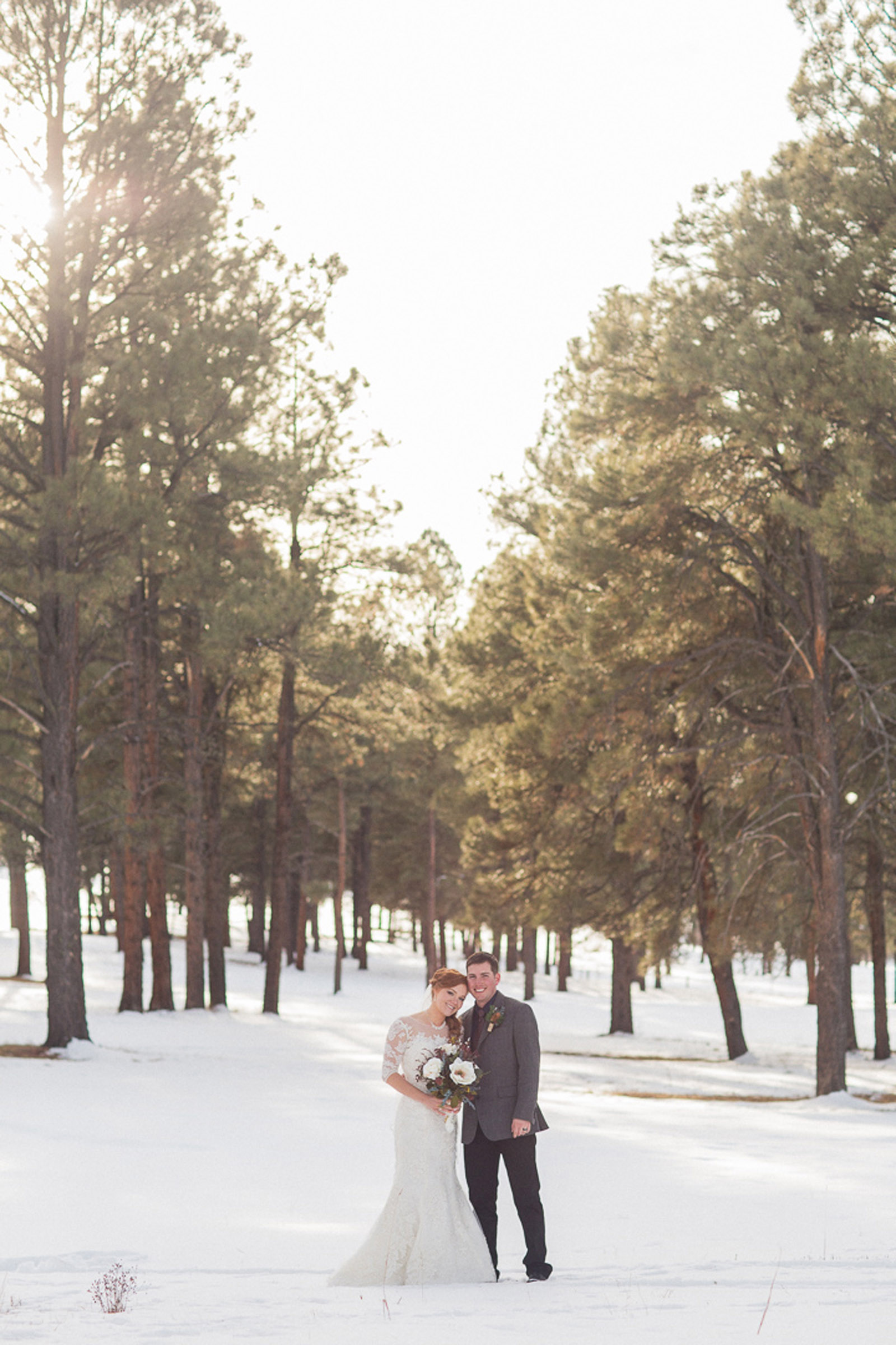 159-wedding-photographer-captures-newlyweds-in-snow-during-a-winter-snow-wedding-in-the-mountains-in-colorado