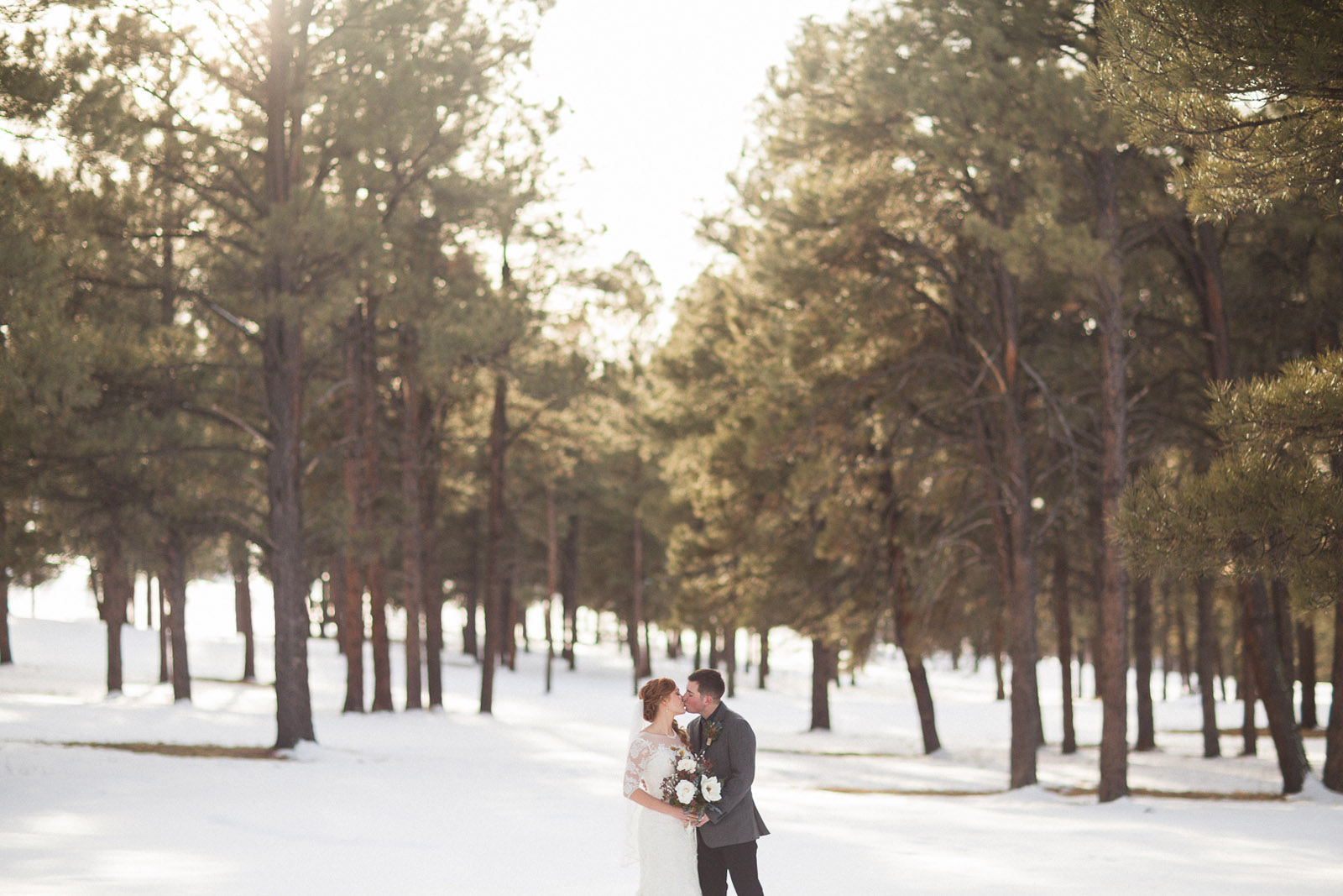 160-wedding-photographer-captures-newlyweds-in-snow-during-a-winter-snow-wedding-in-the-mountains-in-colorado