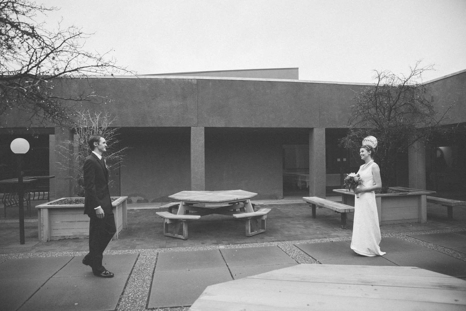 045-bride-and-groom-see-eachother-in-first-look-in-courtyard-before-the-ceremony-in-albuquerque-nm