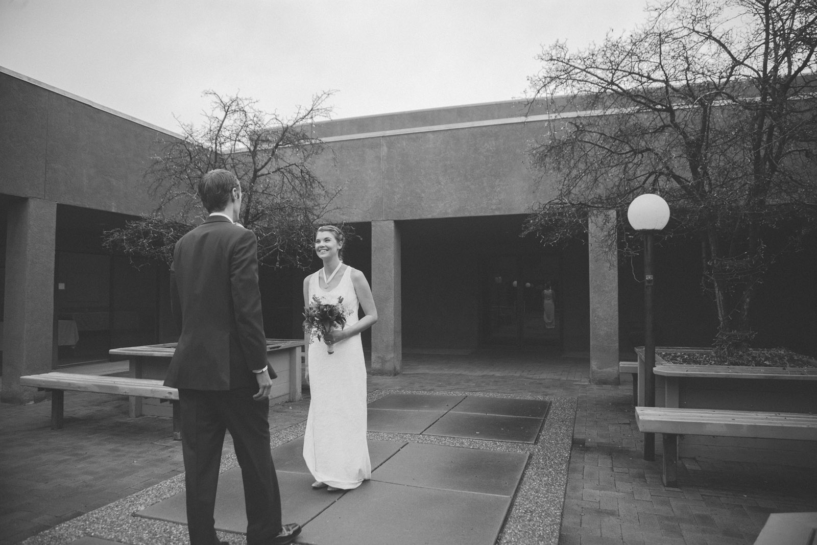 046-bride-and-groom-see-eachother-in-first-look-in-courtyard-before-the-ceremony-in-albuquerque-nm
