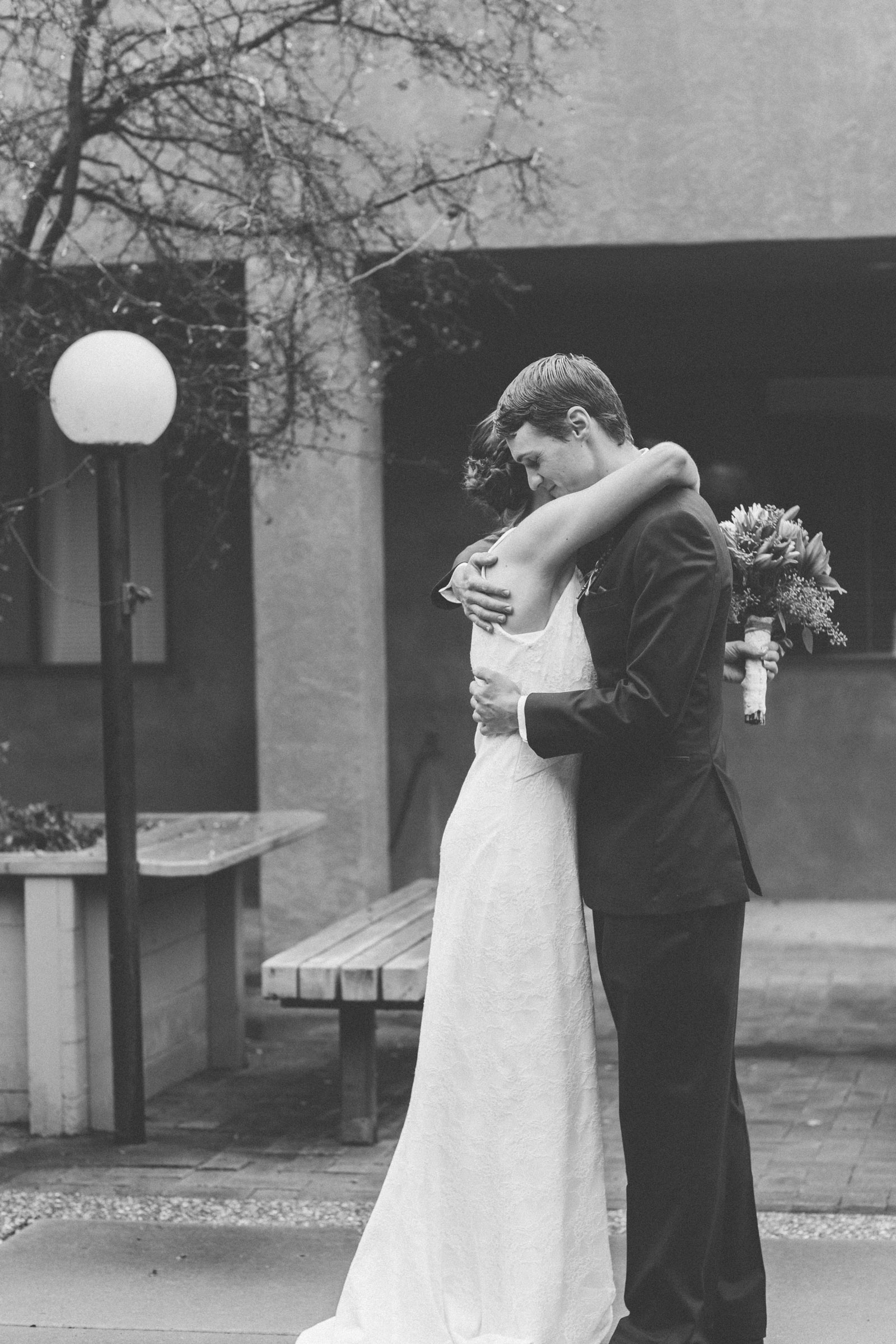 047-bride-and-groom-see-eachother-in-first-look-in-courtyard-before-the-ceremony-in-albuquerque-nm