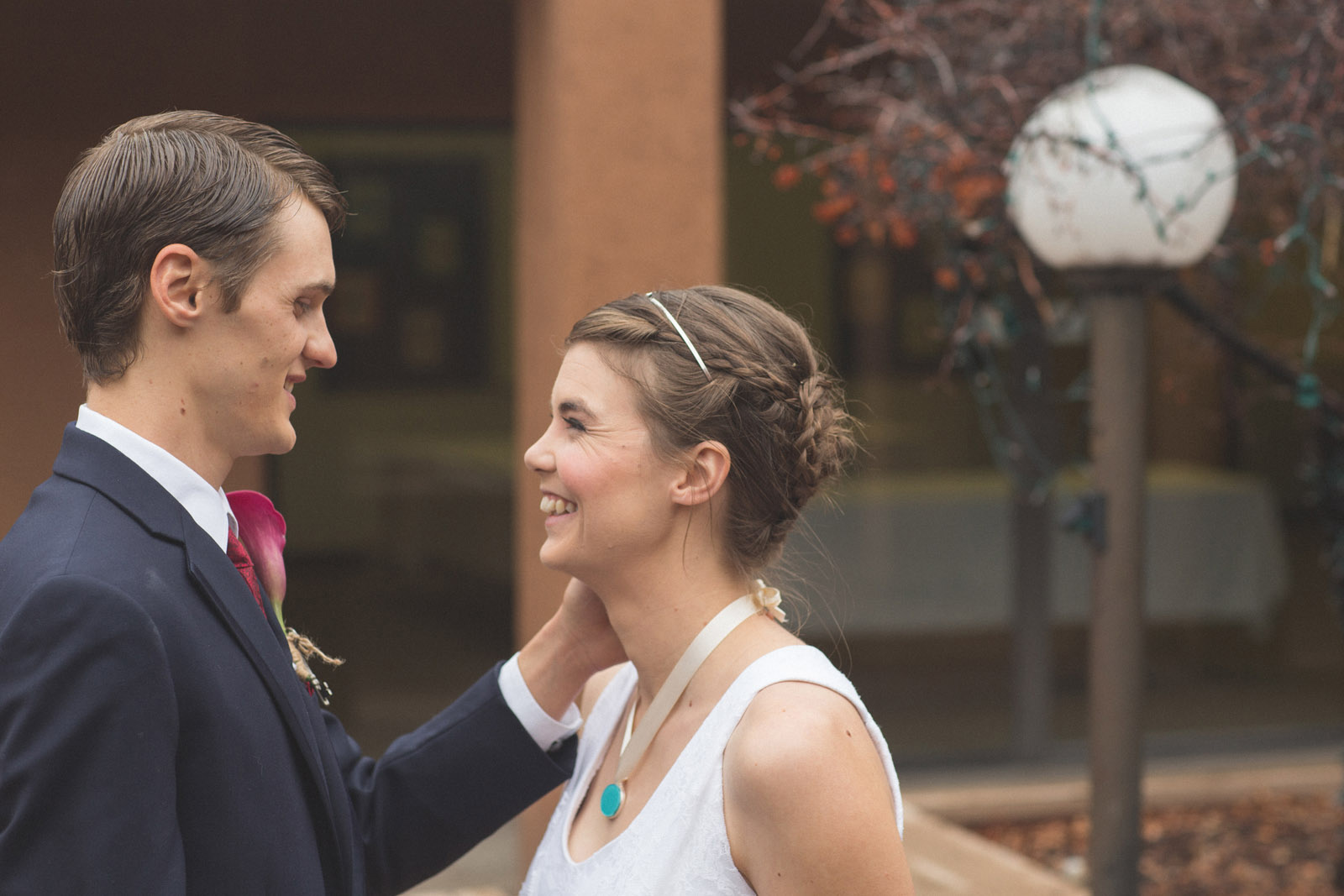 052-bride-and-groom-see-eachother-in-first-look-in-courtyard-before-the-ceremony-in-albuquerque-nm