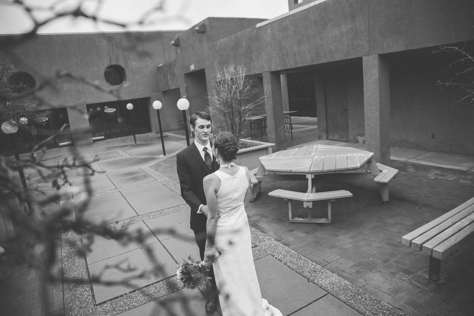 059-bride-and-groom-see-eachother-in-first-look-in-courtyard-before-the-ceremony-in-albuquerque-nm