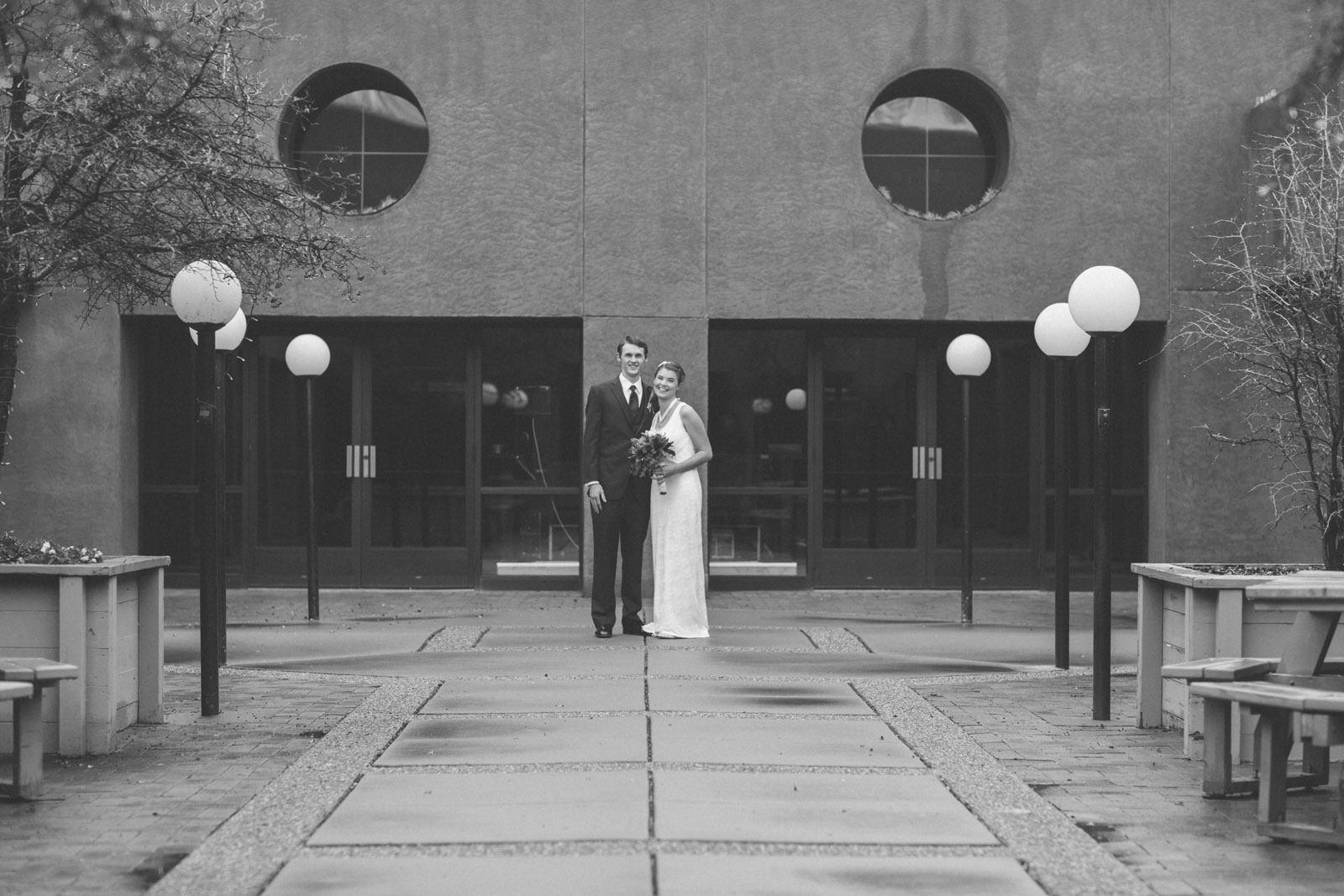066-bride-and-groom-see-eachother-in-first-look-in-courtyard-before-the-ceremony-in-albuquerque-nm