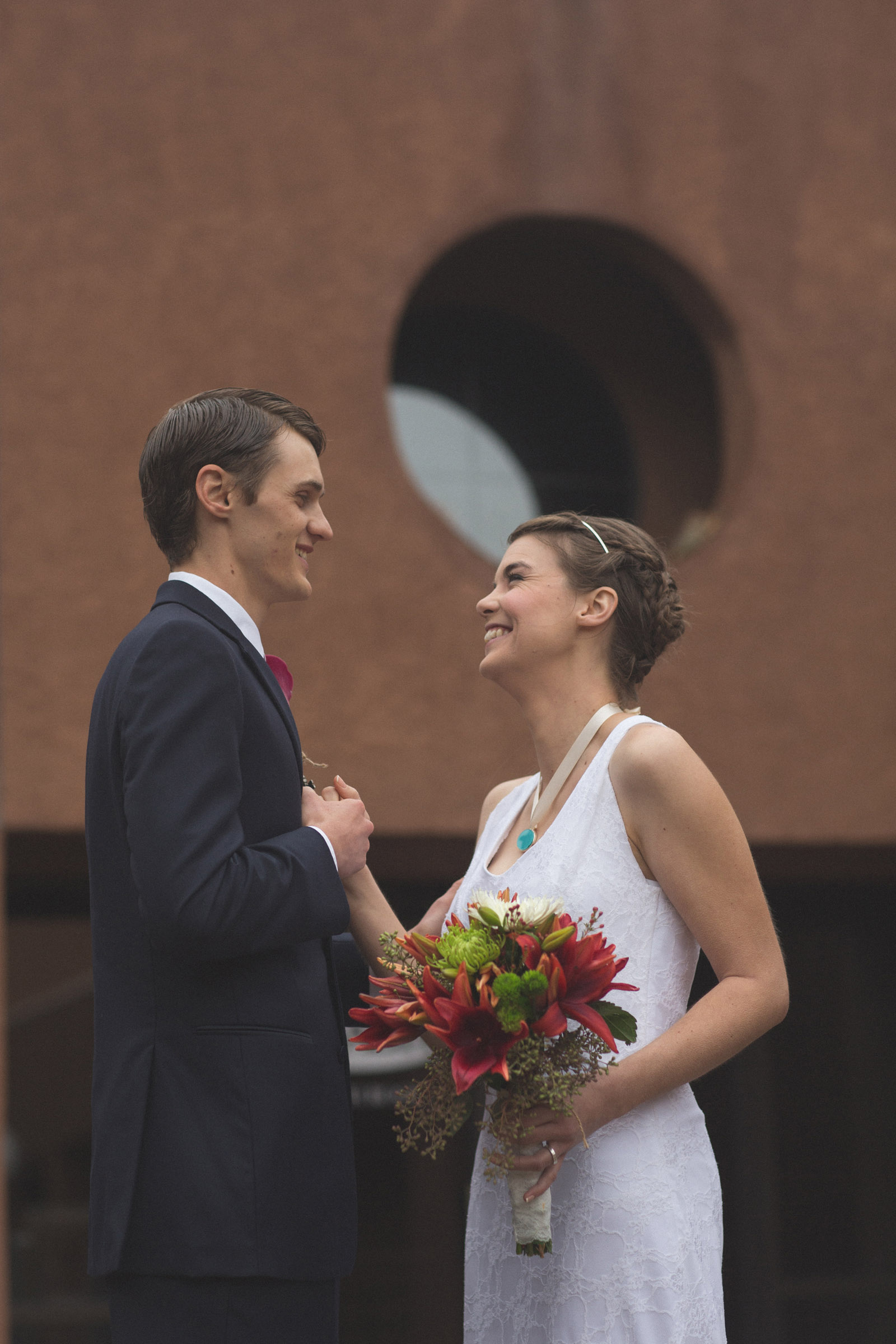069-bride-and-groom-see-eachother-in-first-look-in-courtyard-before-the-ceremony-in-albuquerque-nm